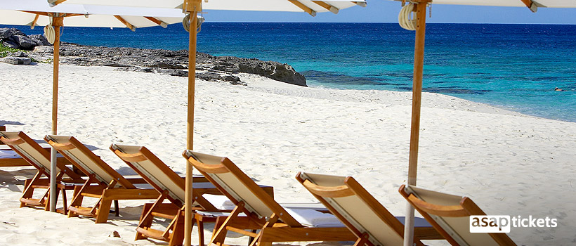 Sunbathing chairs at the beach on vacation - ASAPtickets Travel Guide