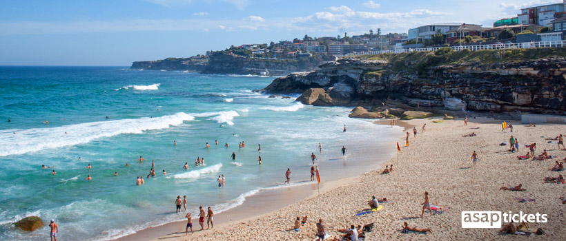 Beach full of people, cheap flights in peak season - ASAPtickets Travel Guide