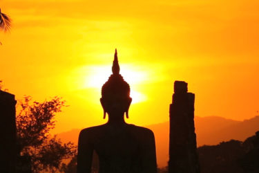 Buddha with temples in sunset - ASAPtickets travel blog