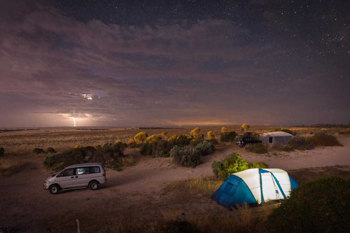 Valentine's Day Vacation Ideas - A car and a tent camping in the desert at night - ASAP Tickets Travel Blog