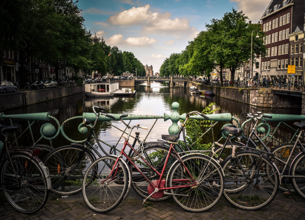 Valentines Day Vacation Ideas - Amsterdam canal with bicycles - ASAP Tickets Travel Blog