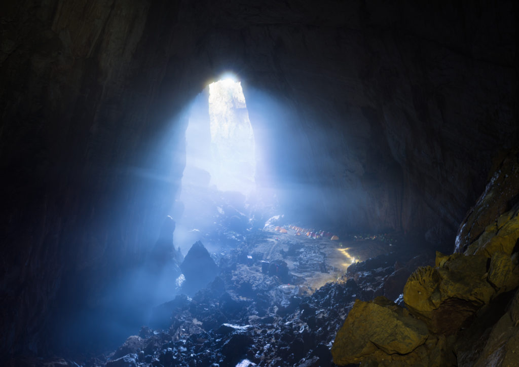 Valentine's Day Vacation Ideas - Mystery misty cave entrance in Son Doong Cave, the largest cave in the world in UNESCO World Heritage Site Phong Nha-Ke Bang National Park, Quang Binh province, Vietnam